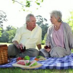 stock-footage-retired-people-having-a-picnic-together-in-a-park